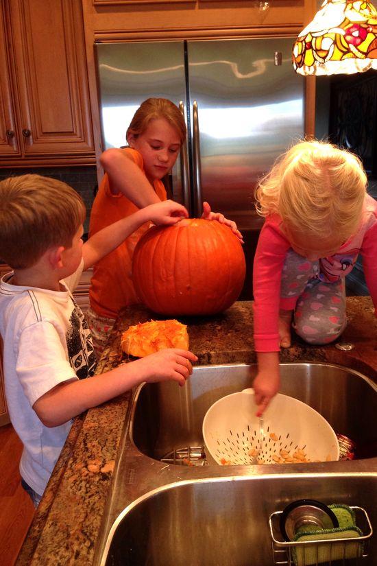 H carving pumpkins